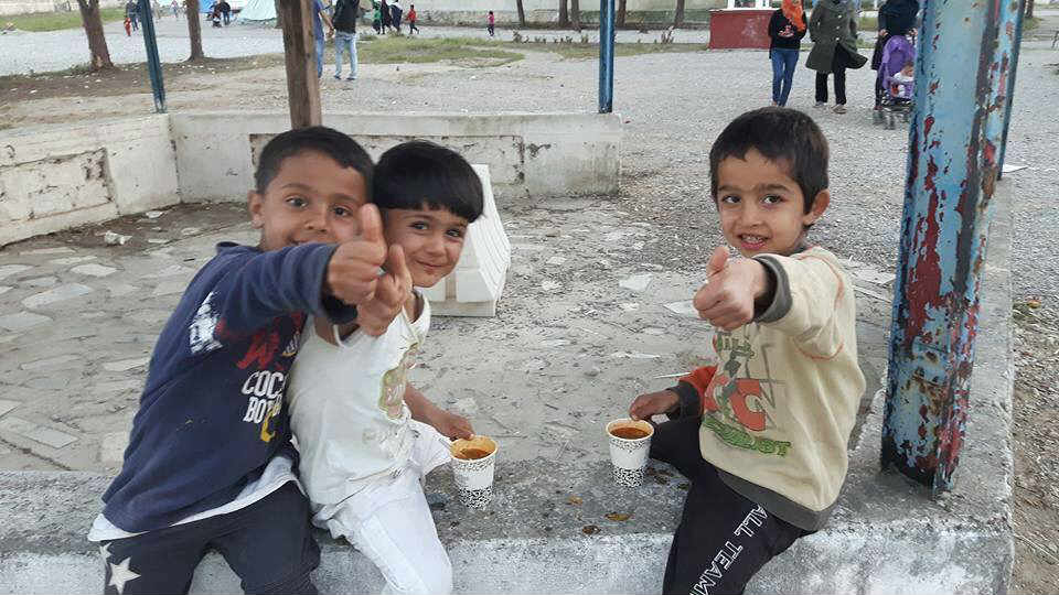 Three young children playing at the Alexandreia Camp, Macedonia