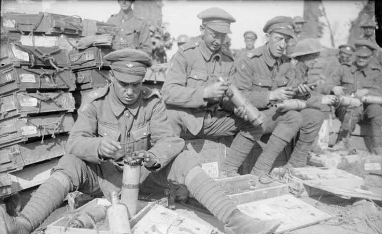 Men of the King's Own Yorkshire Light Infantry fusing trench mortar shells at The Battle of Passchendaele, 1917