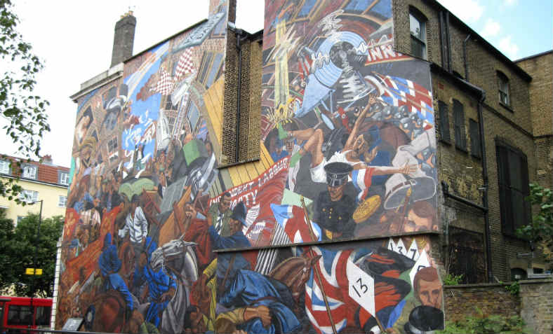 A mural depicting the Battle of Cable Street on the side of St George's Town Hall. Photo: Wikimedia Commons