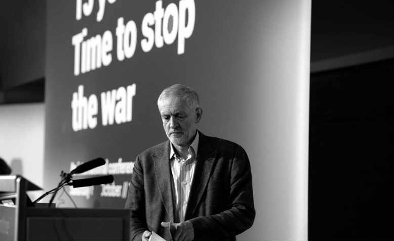Jeremy Corbyn MP consults his notes, Stop the War Coalition conference, London, October 2016. Photo: Jim Aindow
