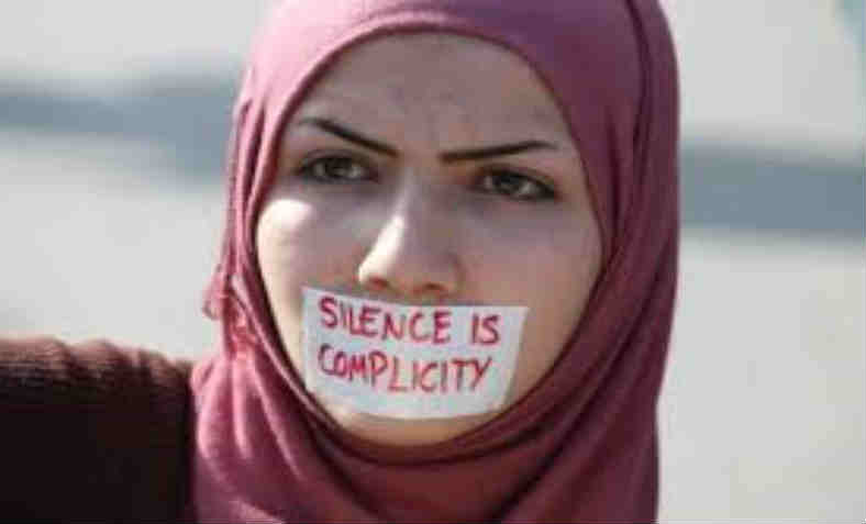 Silence is complicity protestor.  Photo: Islam Awareness Blog