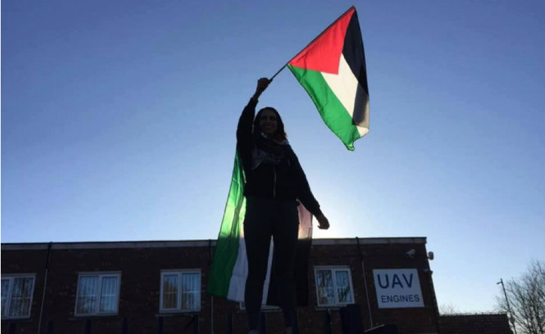 Huda Ammori standing in front of the Elbit Systems-owned arms factory during a protest, 24th November. Photo: Huda Ammori