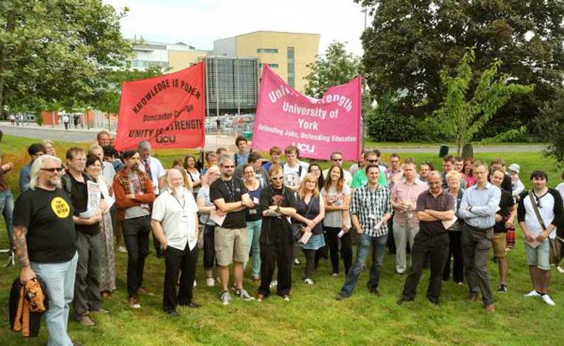 Union members take part in the protest at York College
