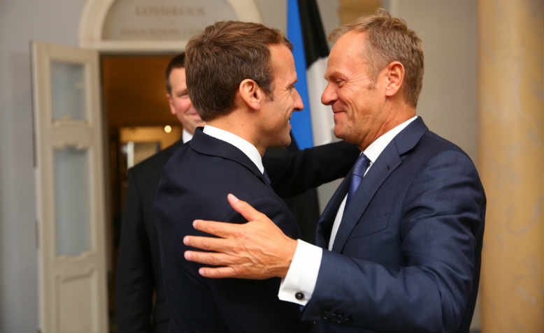 Shady deals: Emmanuel Macron and Donald Tusk embracing in 2017. Photo: Flickr/Arno Mikko