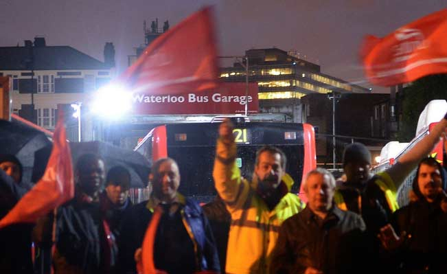 London bus workers strike outside Waterloo Bus Garage in London. Photo: PA