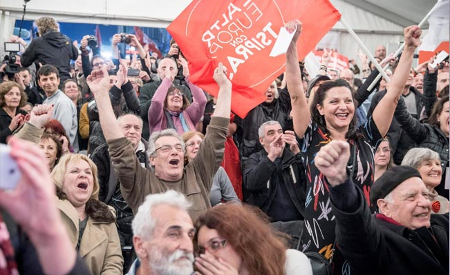 Syriza supporters celebrate after the initial election results in Athens. Photo: EPA