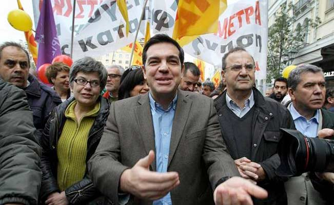 Tsipras joins Syriza party members during a demonstration in Athens. Photograph: Simela Pantzartzi/EPA