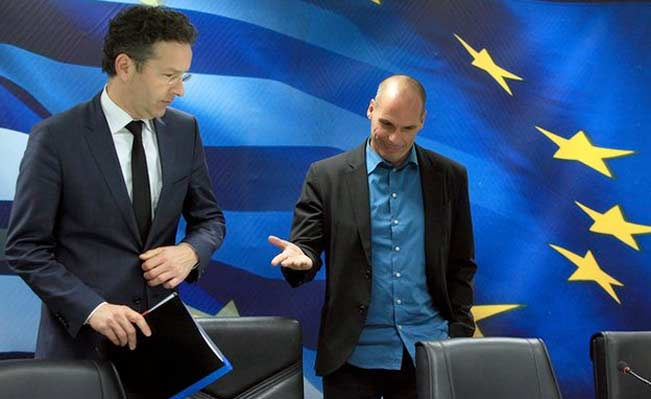 Jeroen Dijsselbloem (left) and Yanis Varoufakis spoke at a rather frosty joint press conference