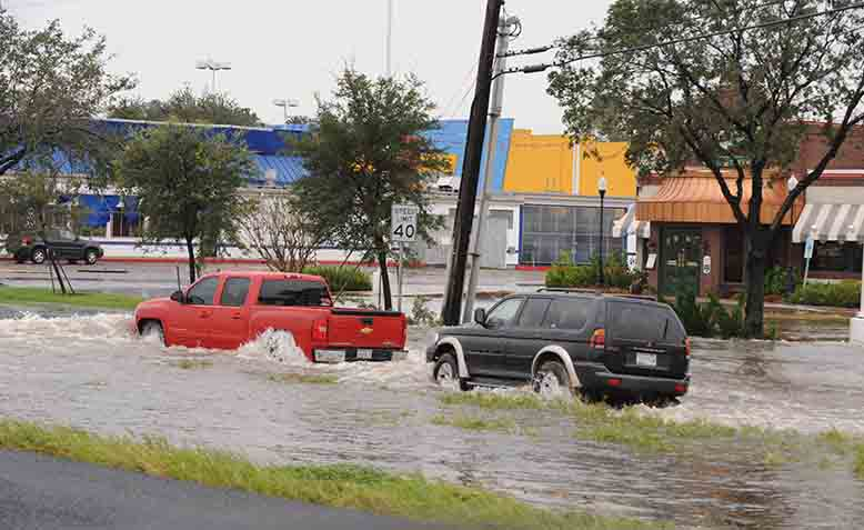 Cars going through flood water in Texas. Photo: Wikipedia