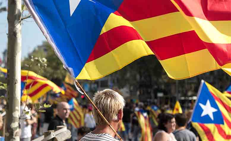 Flag bearer on Catalan National Day. Photo: Wikimedia