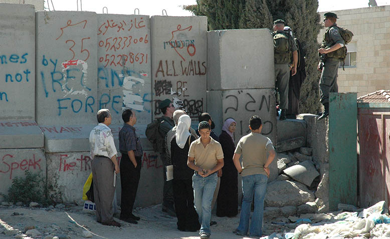 A military checkpoint along the route of the West Bank Barrier, near Abu Dis. Photo: Wikipedia