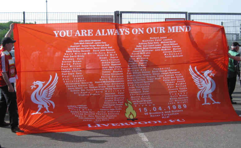 Liverpool fans unfurl a banner in 2006 displaying the names of the 96 dead. Photo: Wikipedia