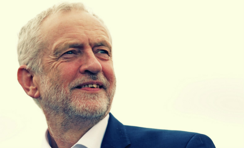An image of Jeremy Corbyn smiling at a public event