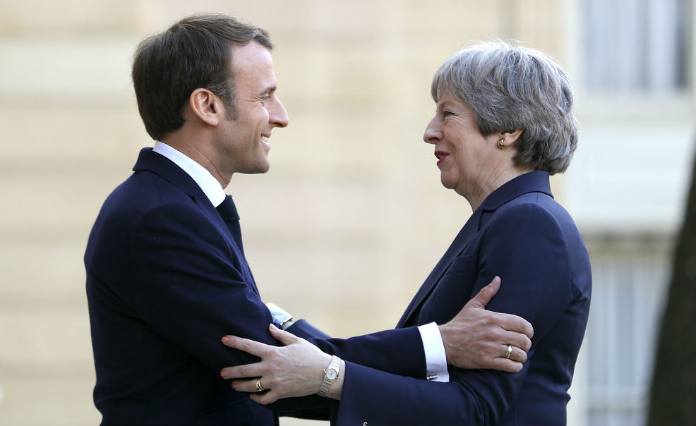 May and Macron embracing