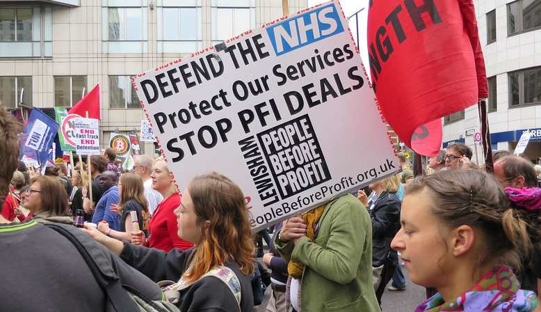 NHS banner at the People's Assembly protests. Source: Flickr - Alan Stanton