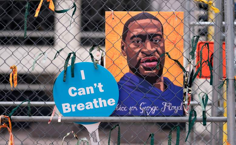Signs that read 'I Can't Breathe' and 'Justice For George Floyd' attached to the security fencing surrounding the Hennepin County Government Center in Minneapolis, Minnesota