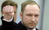 Anders Breivik saluting with fist in the air