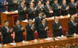 Inside the Chinese Communist Congress members clapping