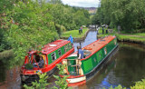 two narrow boats passing each other on the canal