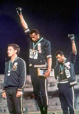US athletes John Carlos and Tommy Smith give the Black Power salute at the 1968 Olympics