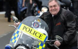 John Prescott sitting on a police motorcycle