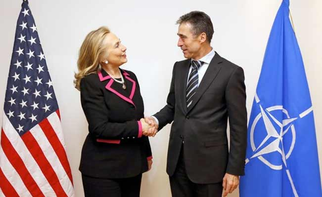 Hillary Clinton and Nato Secretary-General Anders Fogh Rasmussen at the Nato headquarters in Brussels Tuesday Dec. 4, 2012. (Kevin Lamarque/Associated Press)