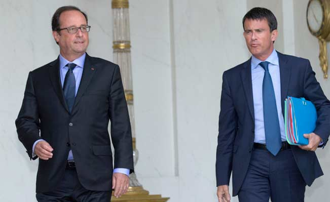French President Francois Hollande and Prime Minister Manuel Valls. Photograph: Reuters / Philippe Wojazer