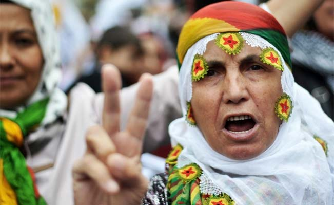 A Kurdish woman flashes a victory sign on September 22, 2013, during a demonstration in Istanbul.Photograph:AFP/Ozan Kose