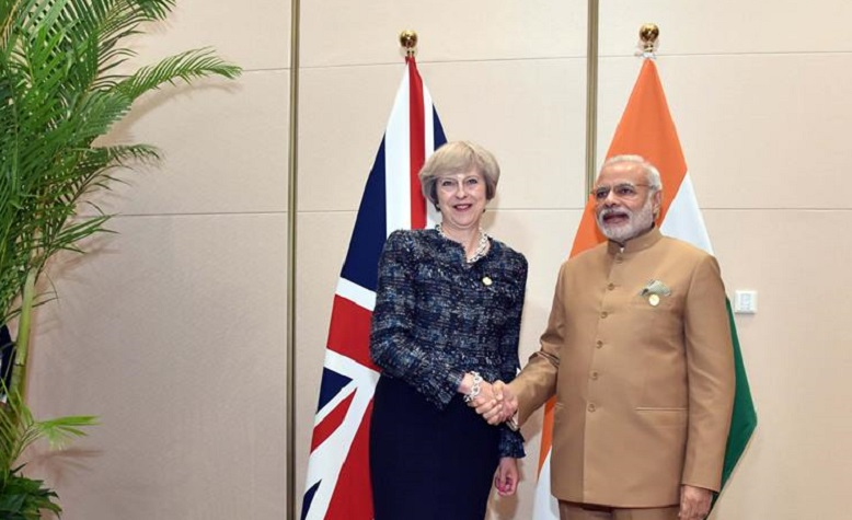 Theresa May and Narendra Modi. Photo: Wikimedia Commons
