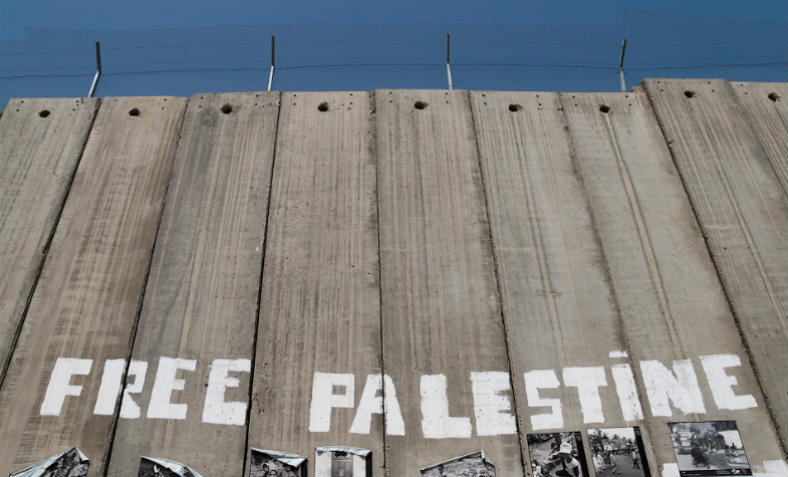 "Israel's Wall in Bethlehem, West Bank, April 2011, on which has been neatly painted ""free Palestine"" in large letters."