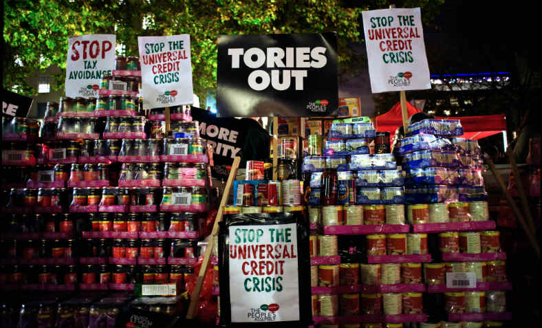 Stacks of canned food donated for foodbanks at the People's Assembly's 'Tories Out' protest demanding an end to the Universal Credit crisis and austerity, outside Downing Street, November 21 2017.  Photo: Jim Aindow.