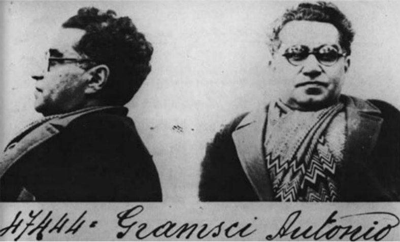 Two photos of Gramsci, side by side, from 1933: one profile and one head-on.