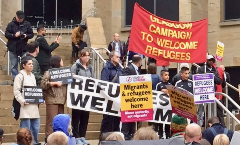 'Refugees welcome' signs