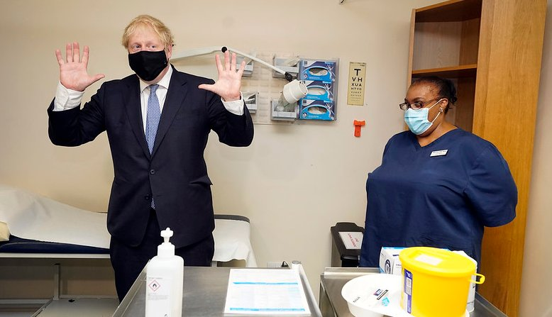 Boris Johnson with a healthcare worker. Photo: Andrew Parsons / No 10 Downing Street /Flickr / cropped from original / licensed under CC 2.0, links at the bottom of article