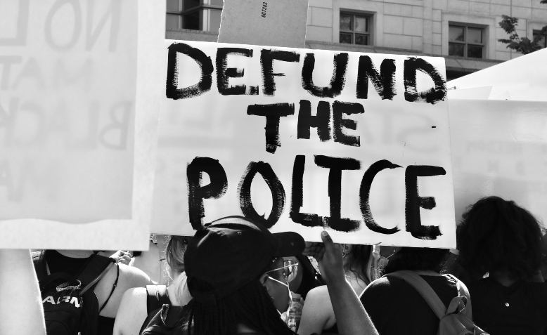 Defund the police. Photo: Taymaz Valley / Flickr / cropped from original / CC BY 2.0, licence and original photo linked at bottom of article