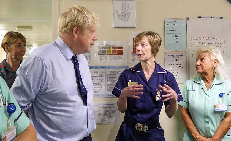 Boris Johnson visits an NHS hospital, Photo: Number 10 Flickr / cropped from original / licensed under CC BY-NC-ND 2.0, linked at bottom of article