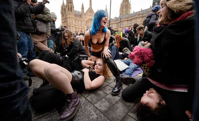 Face-sitting protest outside Parliament. Photo by Leon Neal/AFP Photo