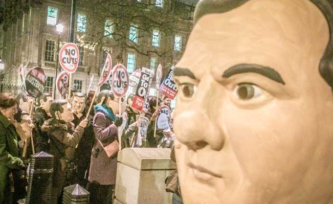 People's Assembly protest at Downing Street ahead of the Statement. Photo: Jim Thatcher