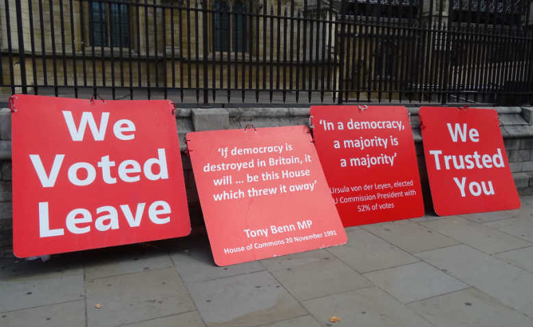 Pro-Brexit signs outside Parliament. Photo: Wikimedia Commons