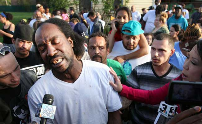 Charles Ramsey being interviewed after he helped release three women and a girl from the house where they had been imprisoned