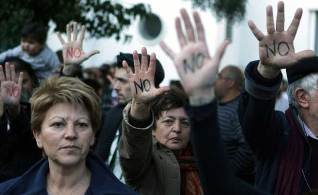 Cypriots hold up their palms reading
