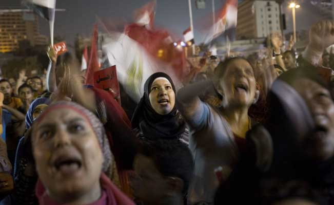 Egyptian women protest against Morsi in Tahrir Square in Cairo, Thursday, June 27, 2013 Photo credit: AP/Manu Brabo