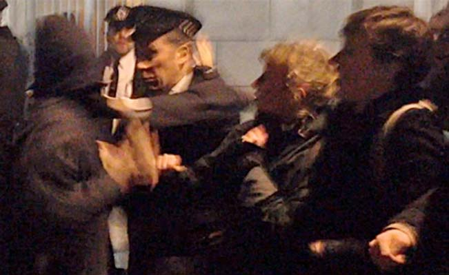 Video still of police violence at Senate House