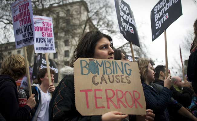 A Stop the War protestor outside Downing Street. Photo: Jim Aindow