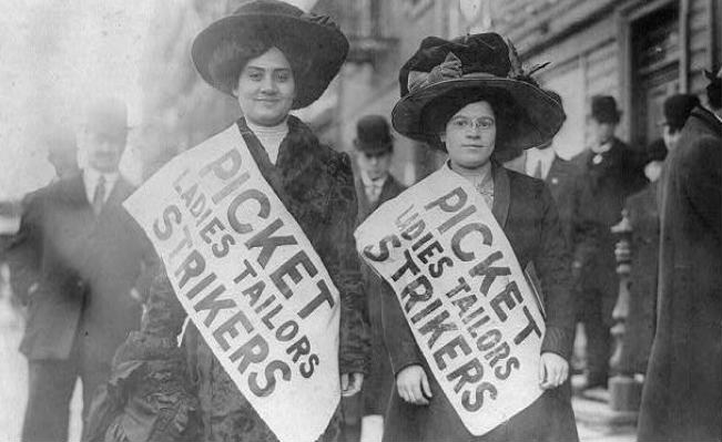 Two women strikers on a picket line