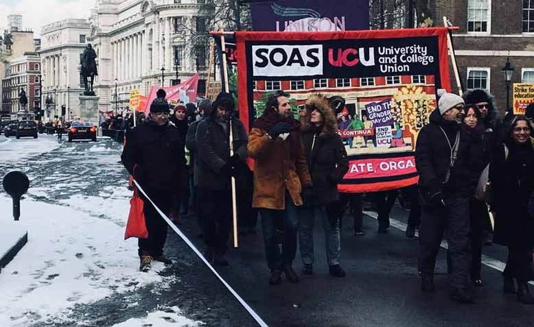 SOAS fly their banner on the students solidarity march. London, Wednesday 28th February. Photo: Feyzi Ismail