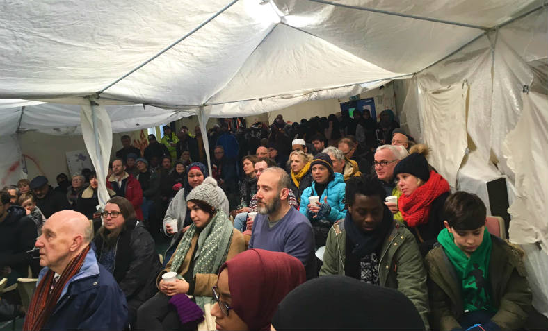 100-strong anti-racist public meeting meeting on the Bahr Academy school site following the 'human chain' protest on Saturday against the Islamophobic attack. Photo: David McAllister