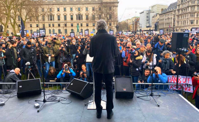 Onstage at demonstration against the extradition of Julian Assange, February 2020. Photo: Sweta Tapan Choudhury