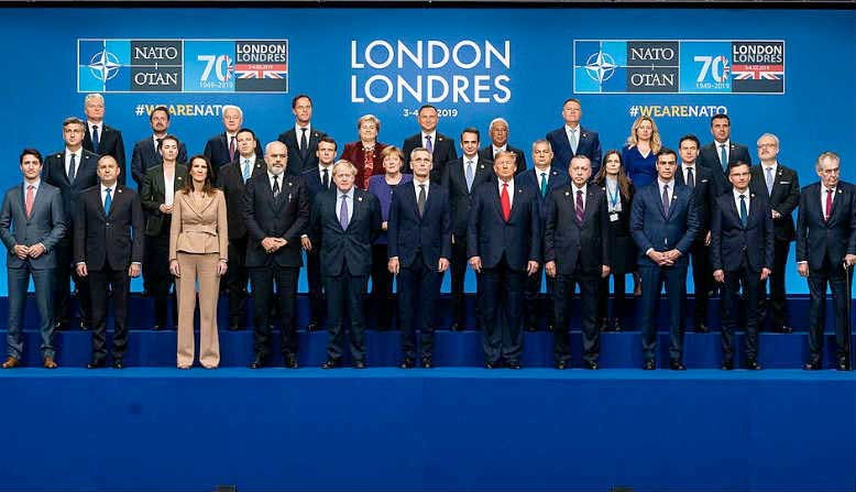 NATO Leaders gather for the traditional family photo. Source: Wikipedia