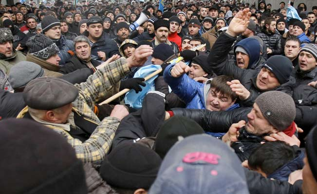 Pro-Russian protesters (right) clash with Crimean Tatars in Simferopol on Wednesday.